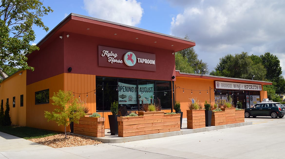 The Flying Horse Taproom is next to Brookside Wine & Spirits.