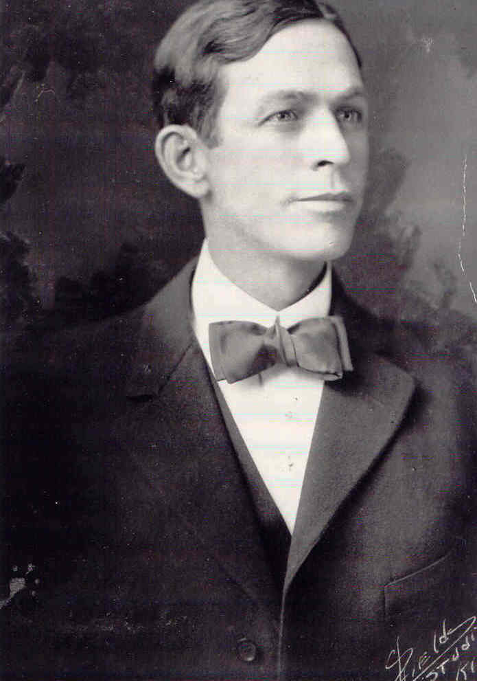 A black and white photo of a man.