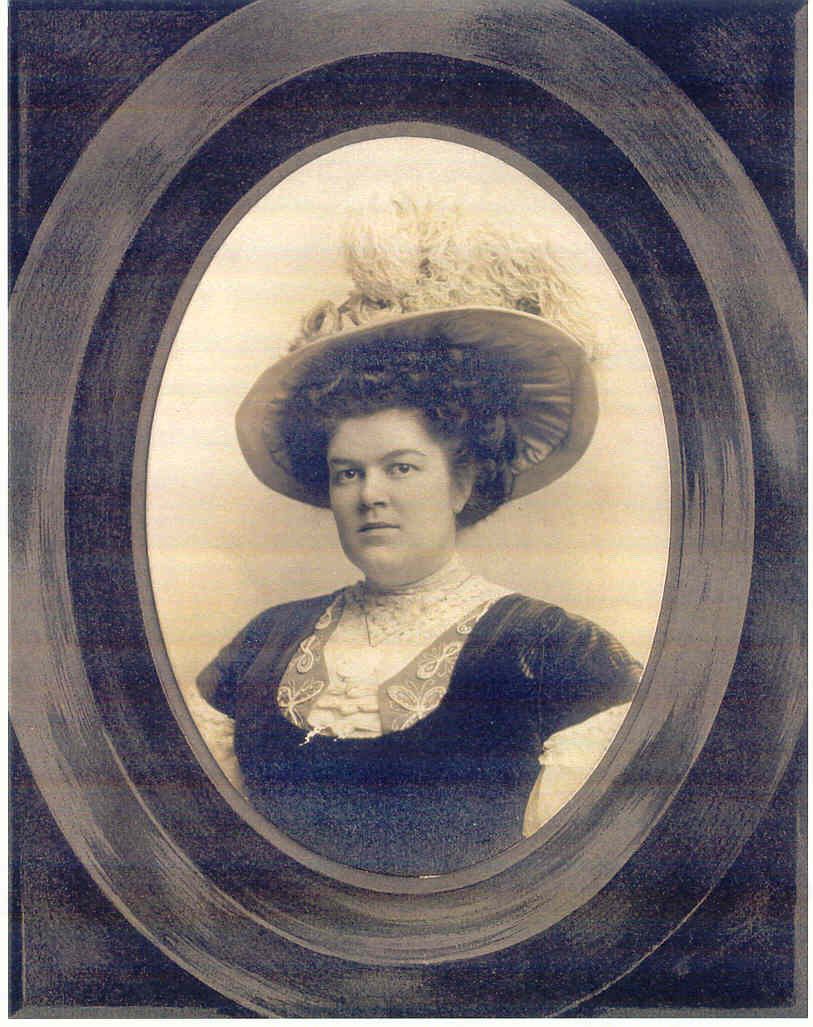 A black and white framed photo of a woman.