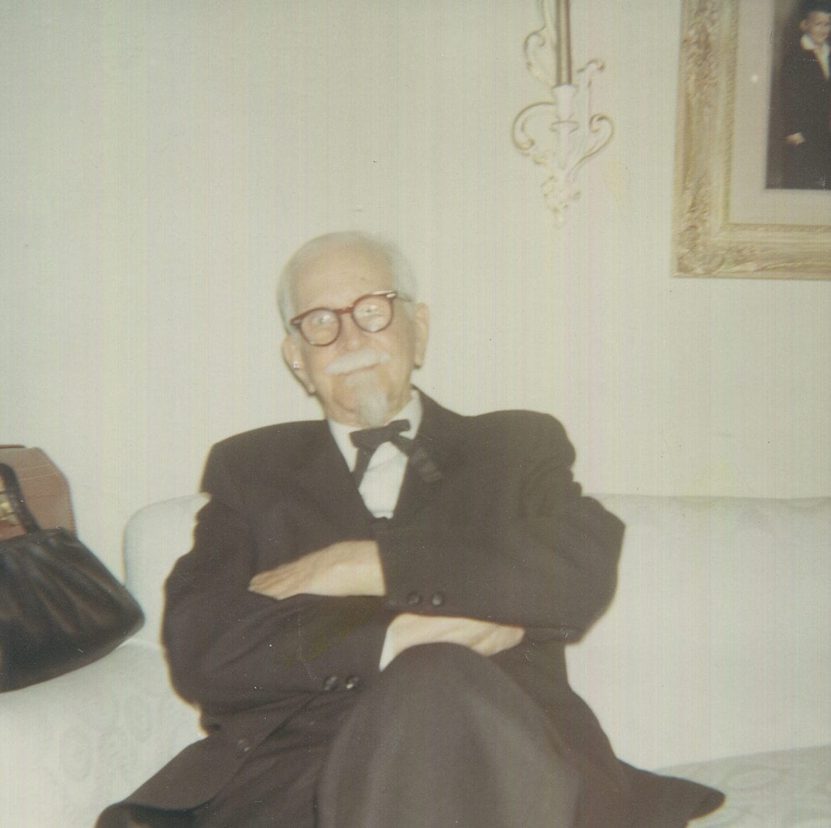 An old photo of a man in a living room.