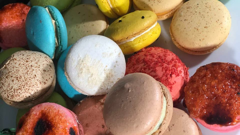 whole kaleidoscope of Covet Bakery's macarons