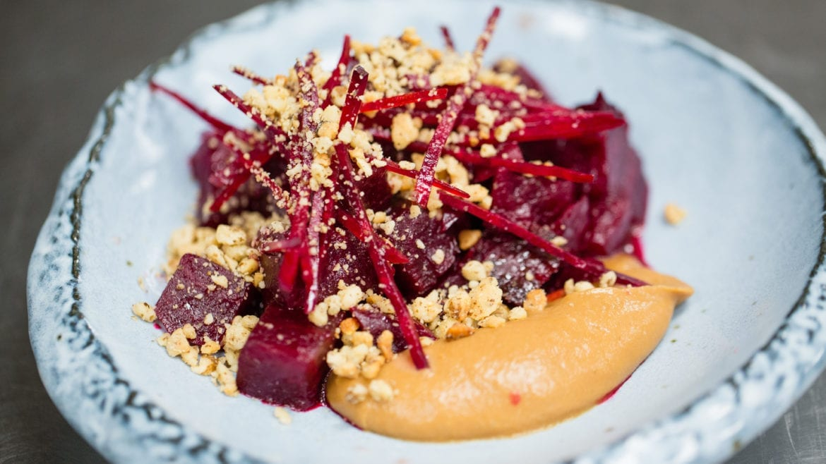 The roasted beets are served with pear butter and black walnuts at Corvino