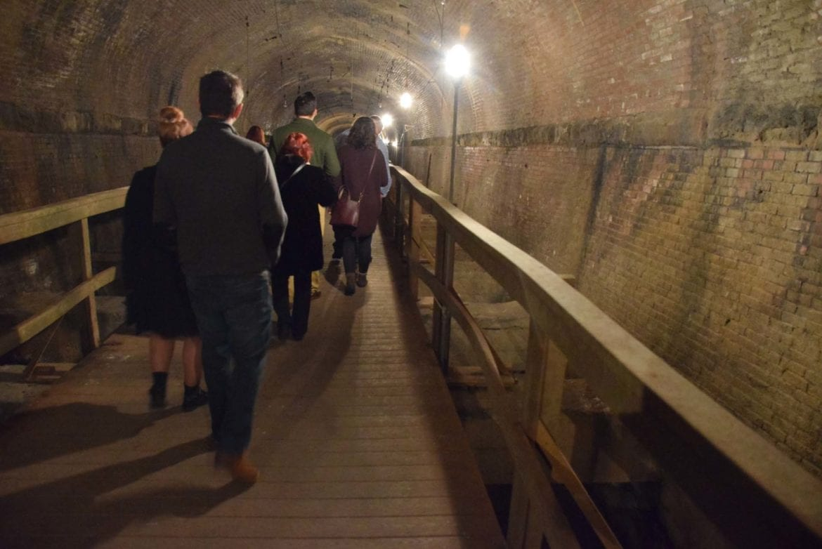 a tour group in the eighth street tunnel