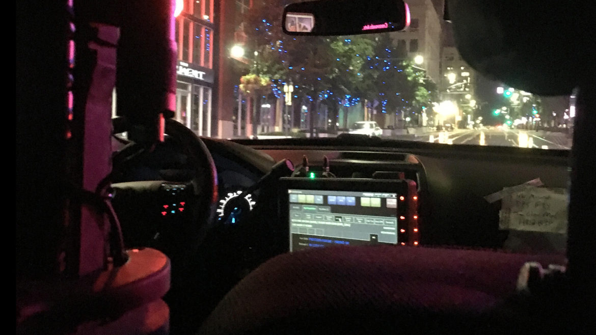inside of police car on patrol