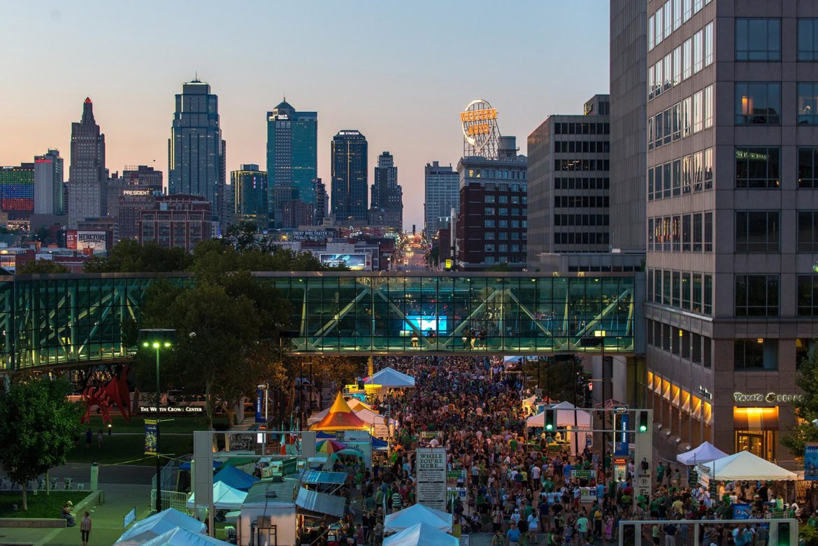 Irish Fest crowd gathers below the Kansas City skyline.