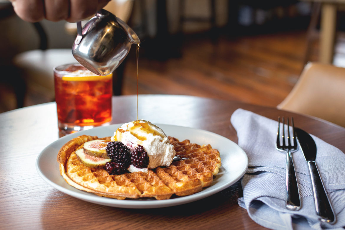 Whiskey syrup is poured over waffles.