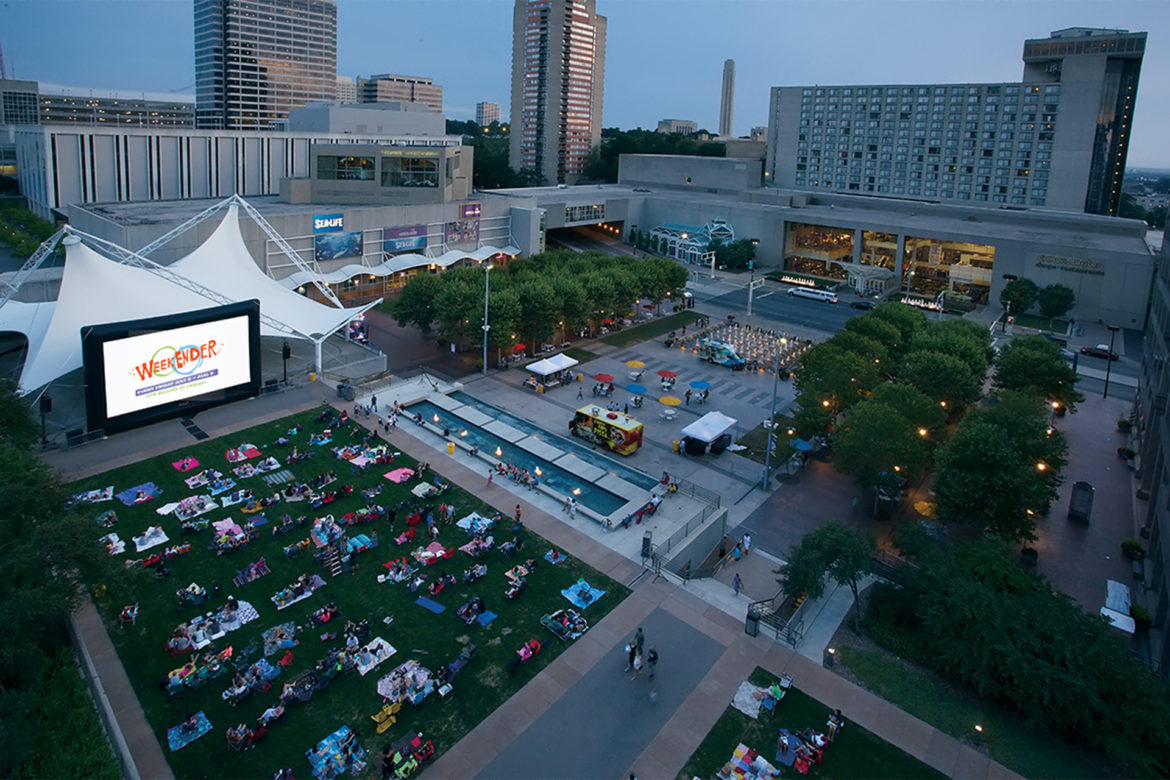 Families gather at Crown Center's WeekEnder Series to watch a show.