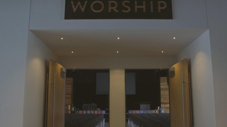 worship sign above sanctuary door