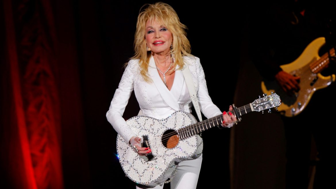 In this July 31, 2015 file photo, Dolly Parton performs in concert at the Ryman Auditorium in Nashville, Tenn. (Photo by Wade Payne/Invision/AP, File)