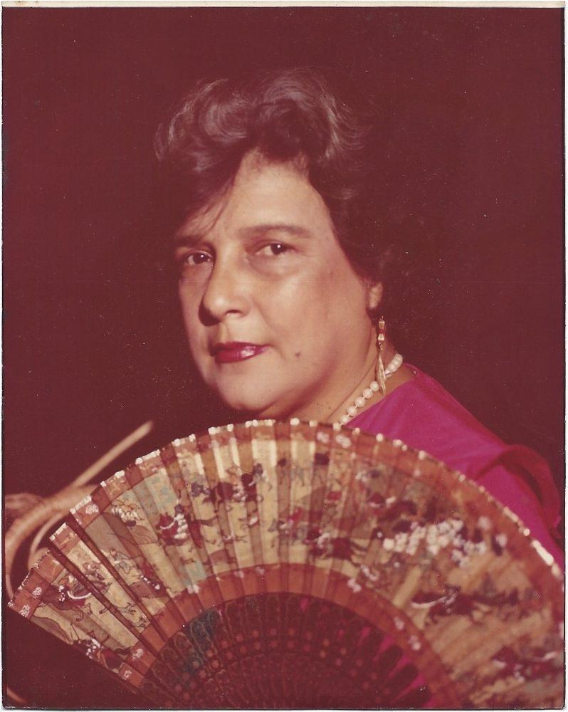 Portrait of women with a fan