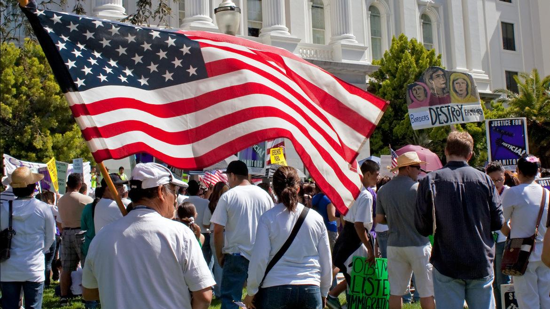 American flag held by man