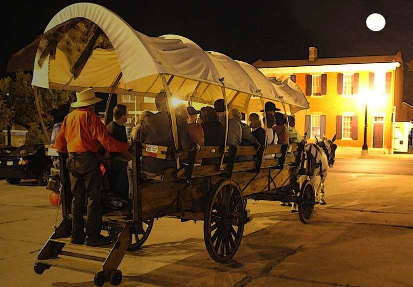 Guests for 1859 Jail Ghost Tours cap their evening with a ride in a mule-drawn wagon.