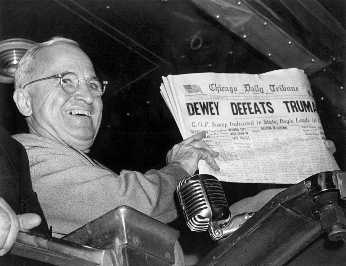 Harry Truman celebrating his upset election victory over Thomas Dewey.