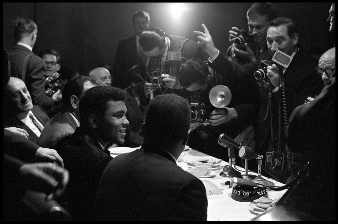 Muhammad Ali interviewed by reporters in London, England,