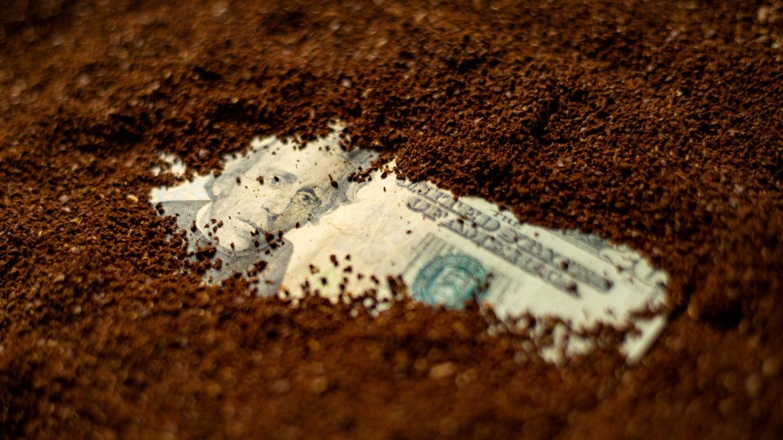 Money buried beneath coffee grounds