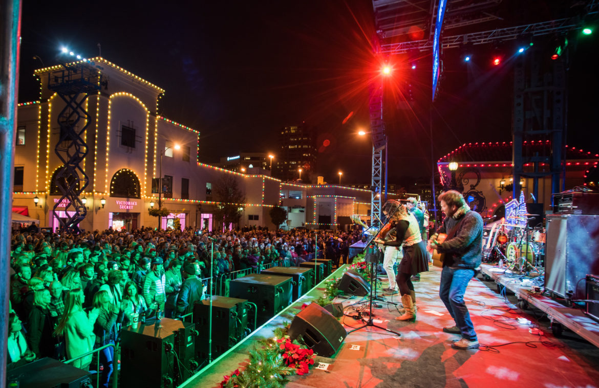 A band plays on stage at the Plaza Lighting Ceremony/