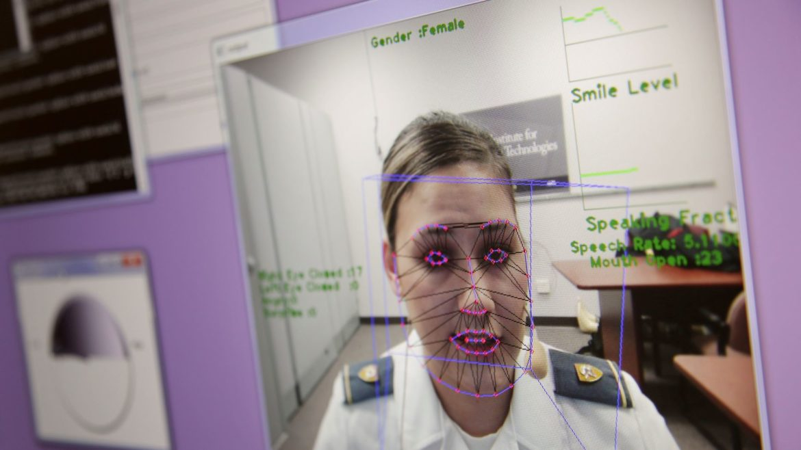 A computer monitors some of Cadet Cheyenne Quilter's reactions as she works with a virtual reality character named