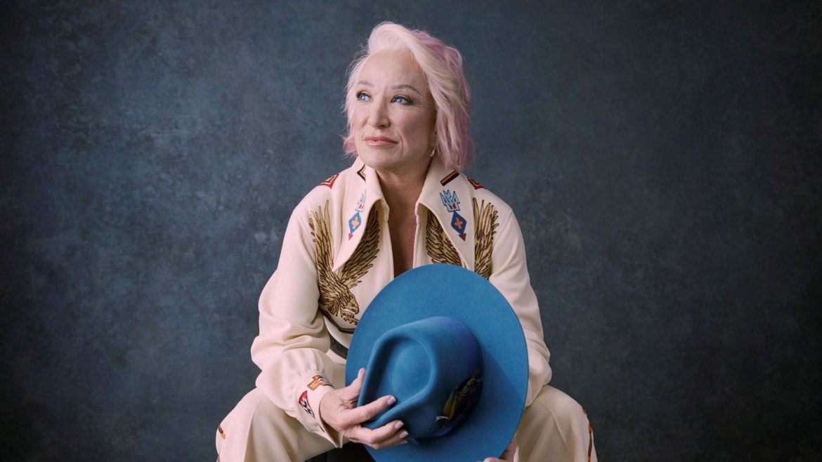 Country music legend Tanya Tucker poses with pink hair.