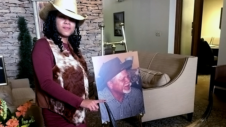 Oralee holds photo of her father, Warren Watkins Jr.