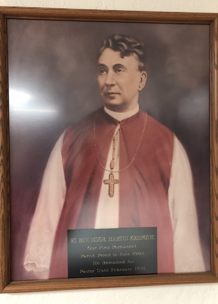 A photo of club founder Msgr. Krmpotic hangs in the club.