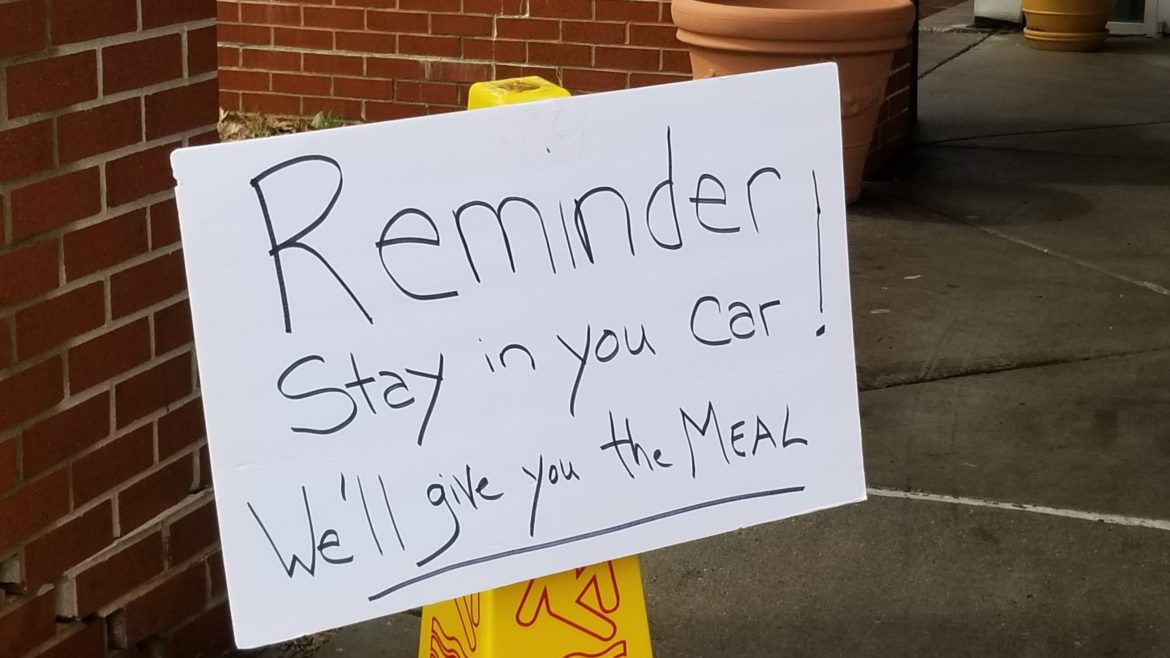 A sign at Don Bosco Senior Center urges clients to stay in their cars.