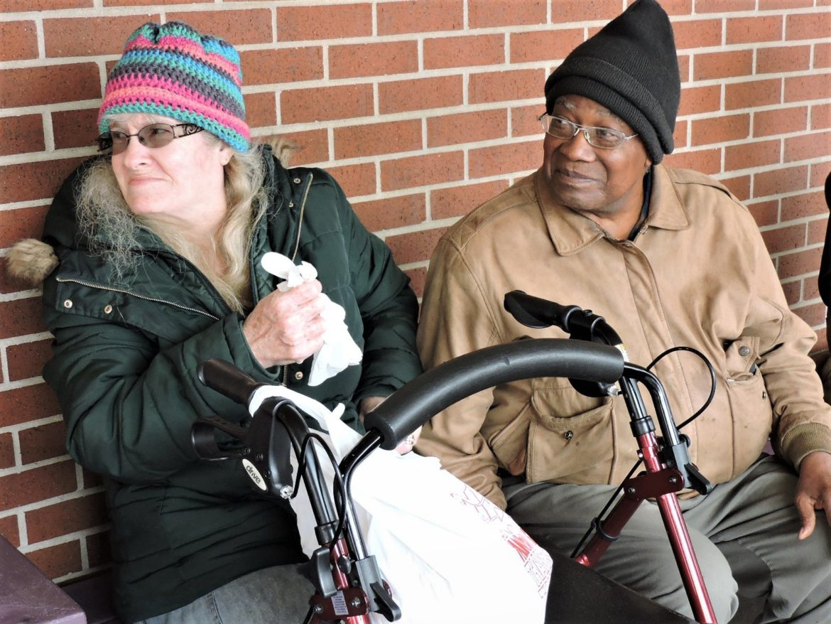 Jayne and Alfonso Newton took three buses to pick up their lunches at the Don Bosco Senior Center.