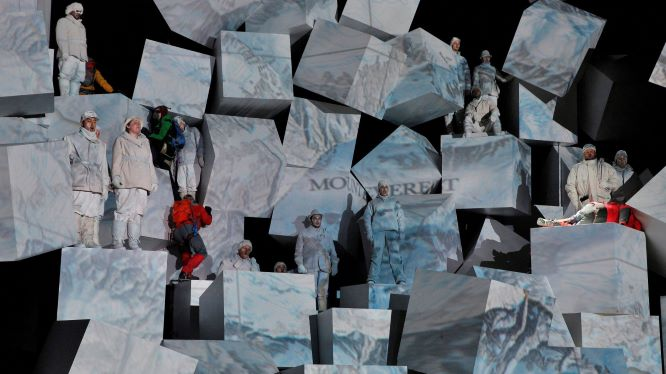 "James Symmonds ascends the 35-foot stage set in the Lyric Opera's production of ""Everest."""