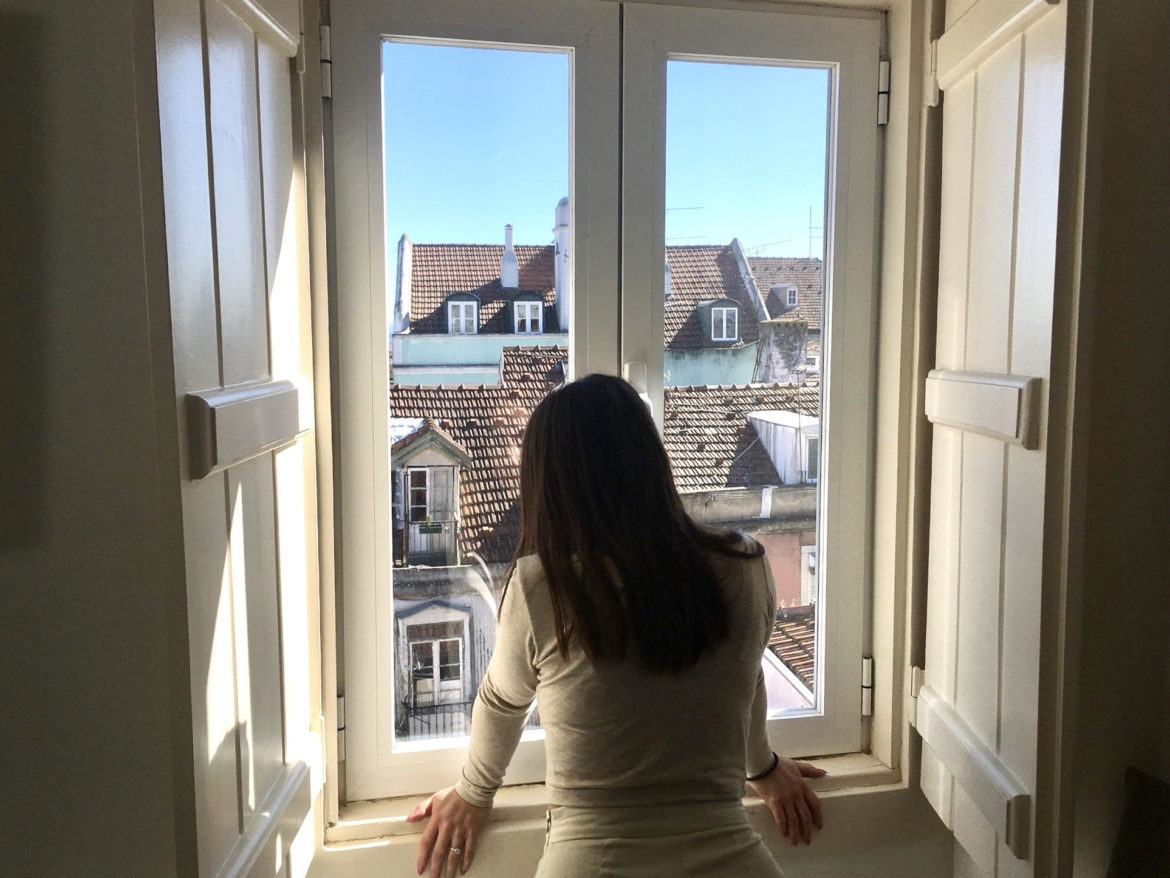 Lady looks at view of Portugal