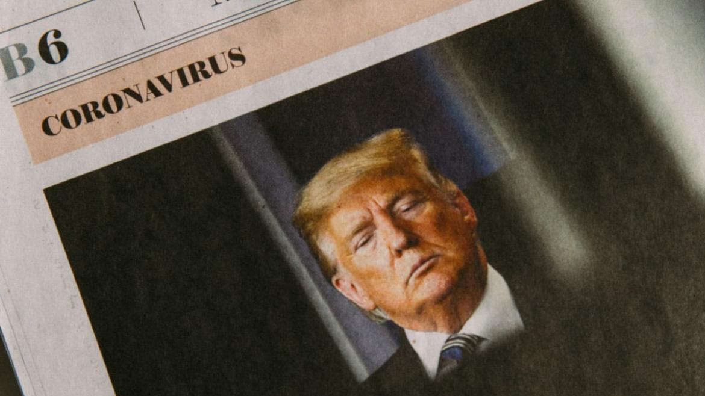 "President Donald Trump in a newspaper under the headline, ""coronavirus"""