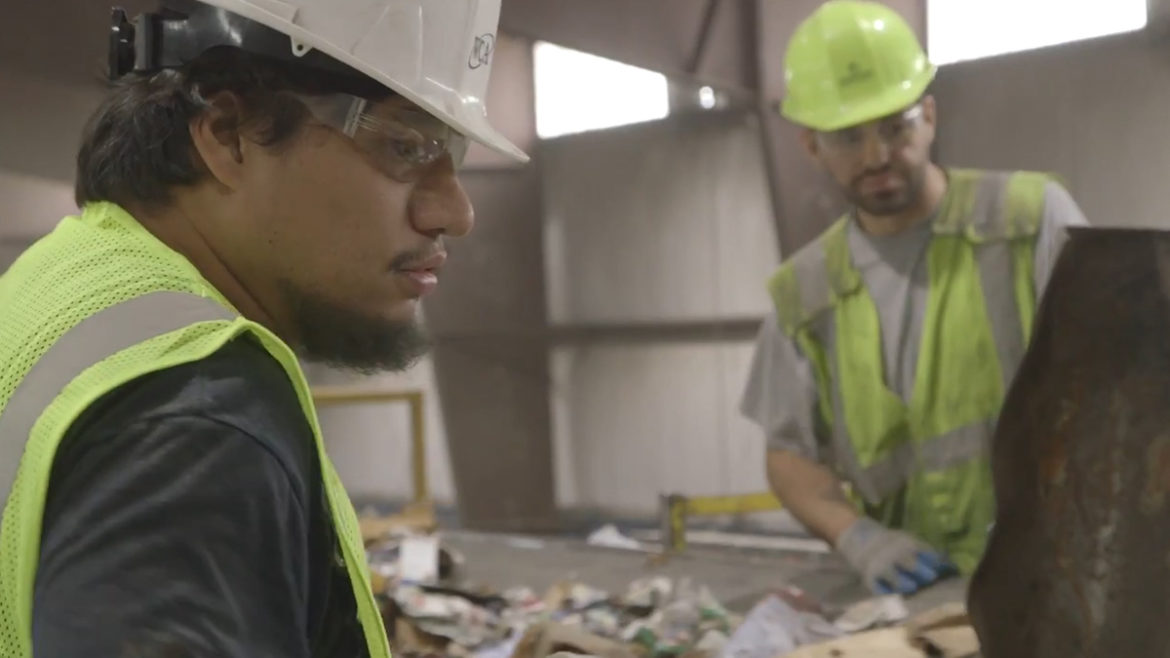 Workers at recycling facility