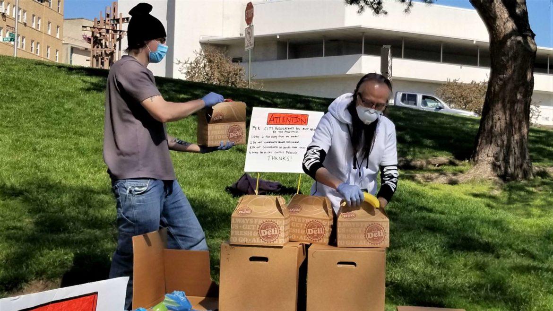 Kar Woo, right, handing out meals.
