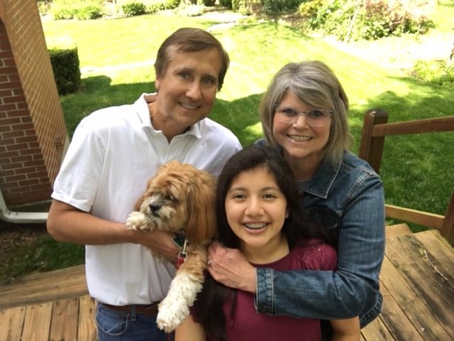 The Moorman family with Cheryl, Tom, Madi, and dog Jordy