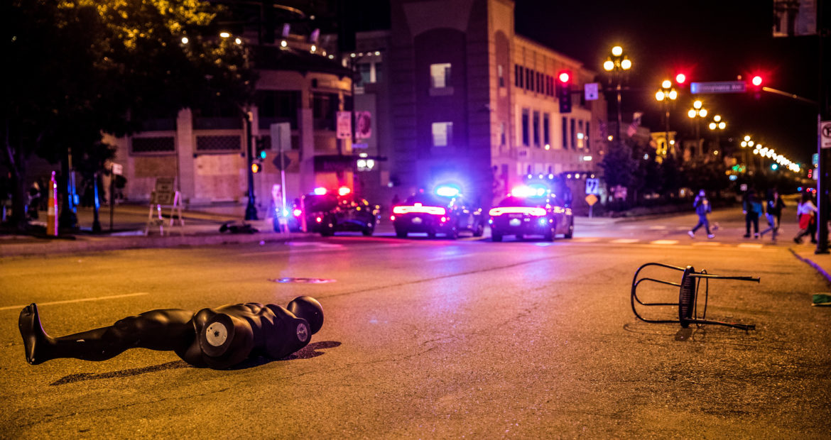A broken mannequin lies in the street on the Country Club Plaza.