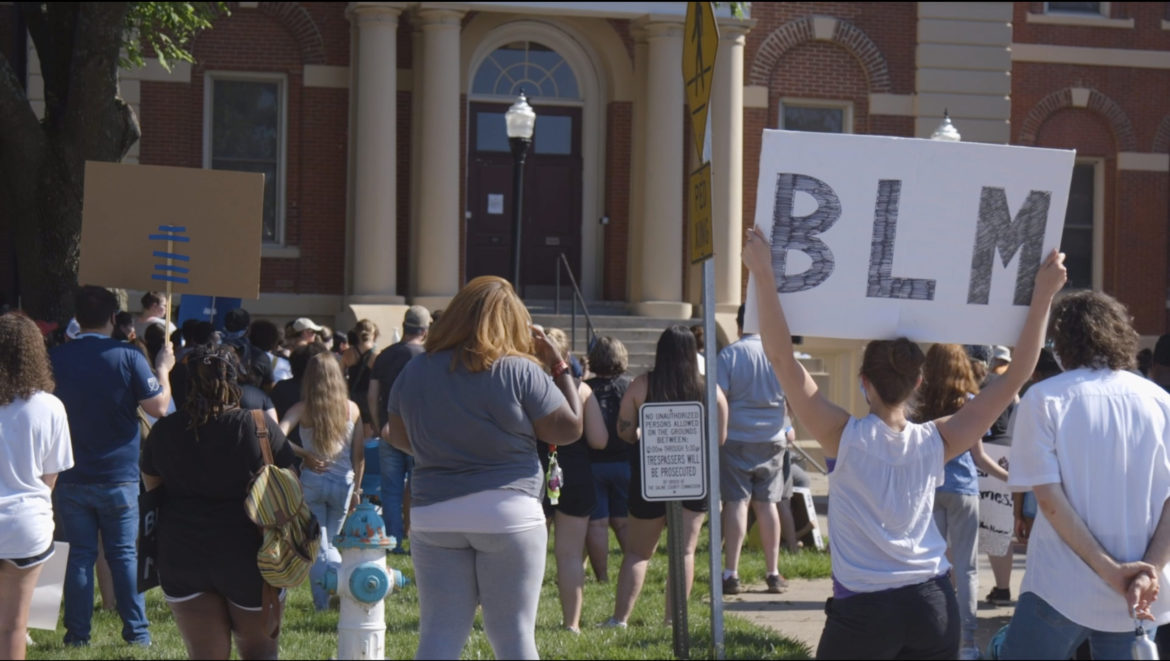 Protesters stand on the north lawn of the Saline County Courthouse in Marshall, Missouri on Sunday, June 7, 2020.