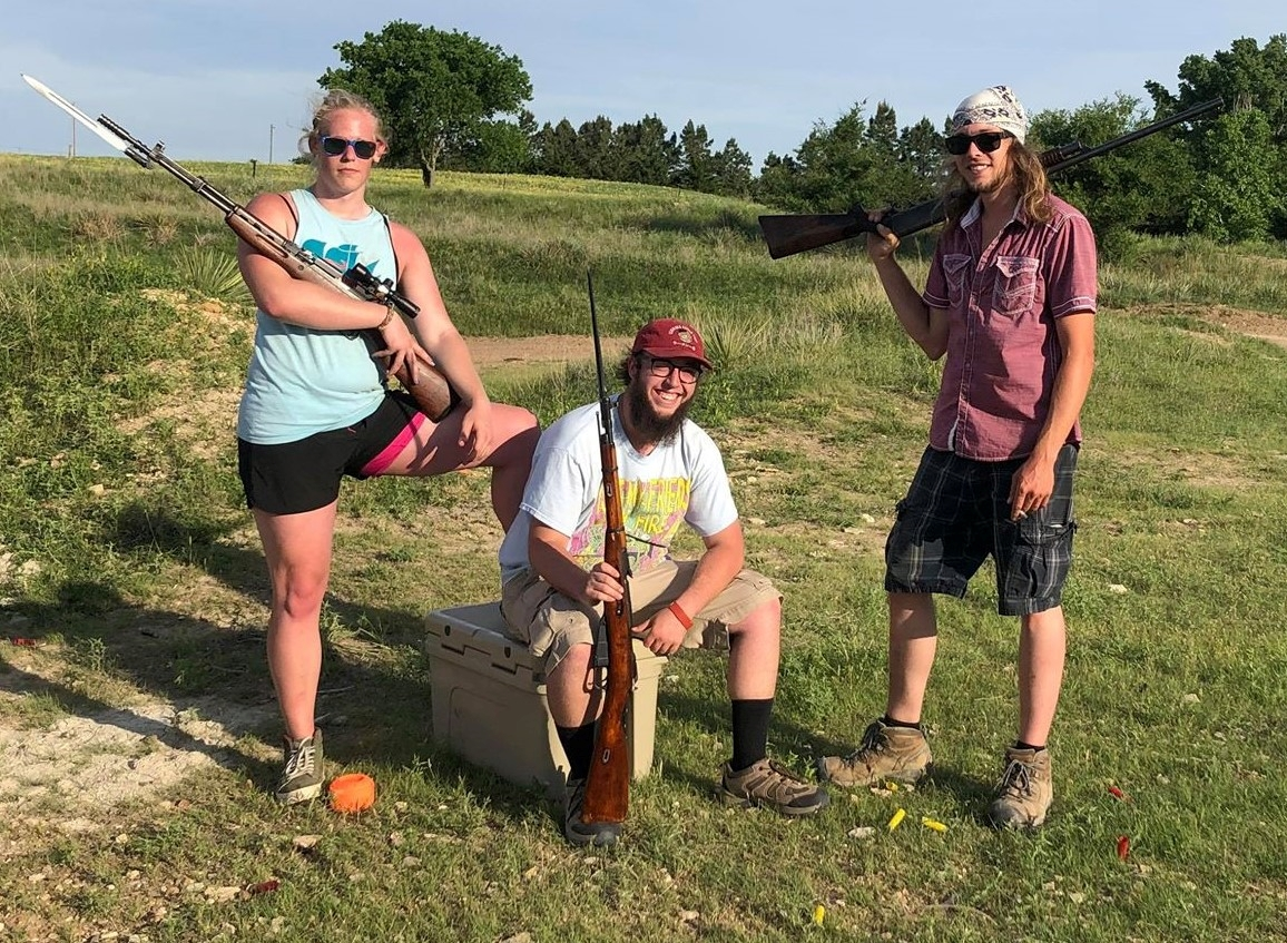 Hunter Brown (center) poses with other members of the Kansas John Brown Gun Club.