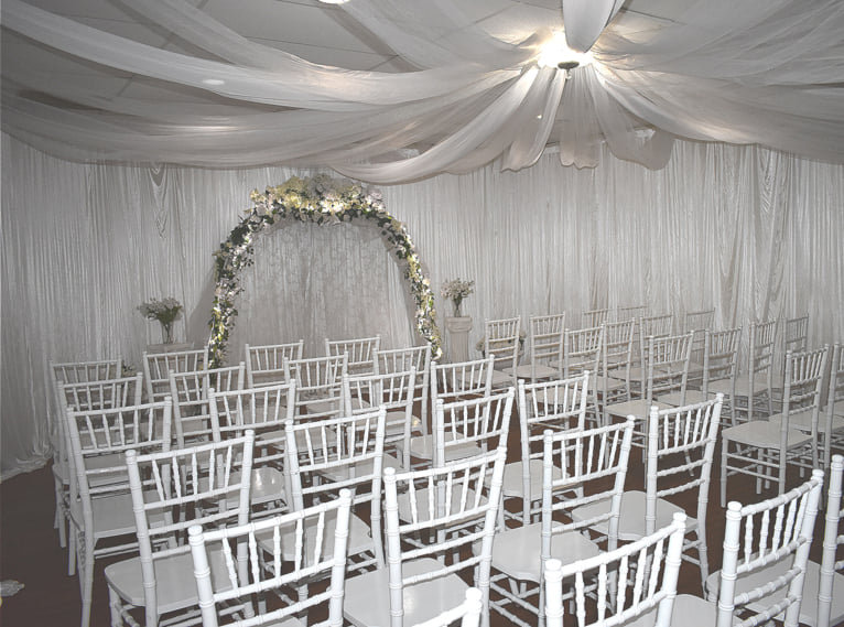 Empty chairs sit in wedding chapel.