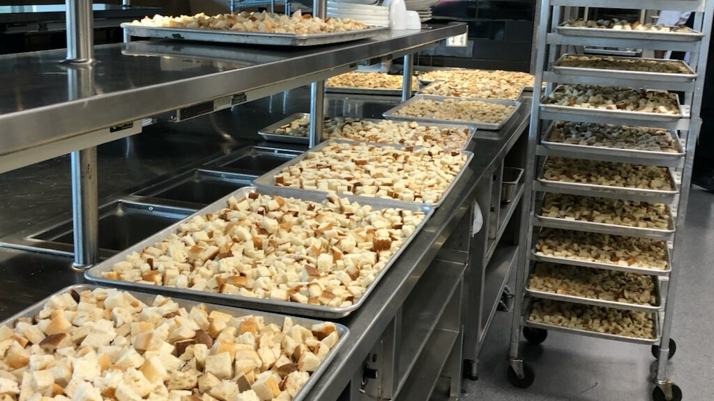 Trays of bread cubes dry in preparation for Thanksgiving stuffing.