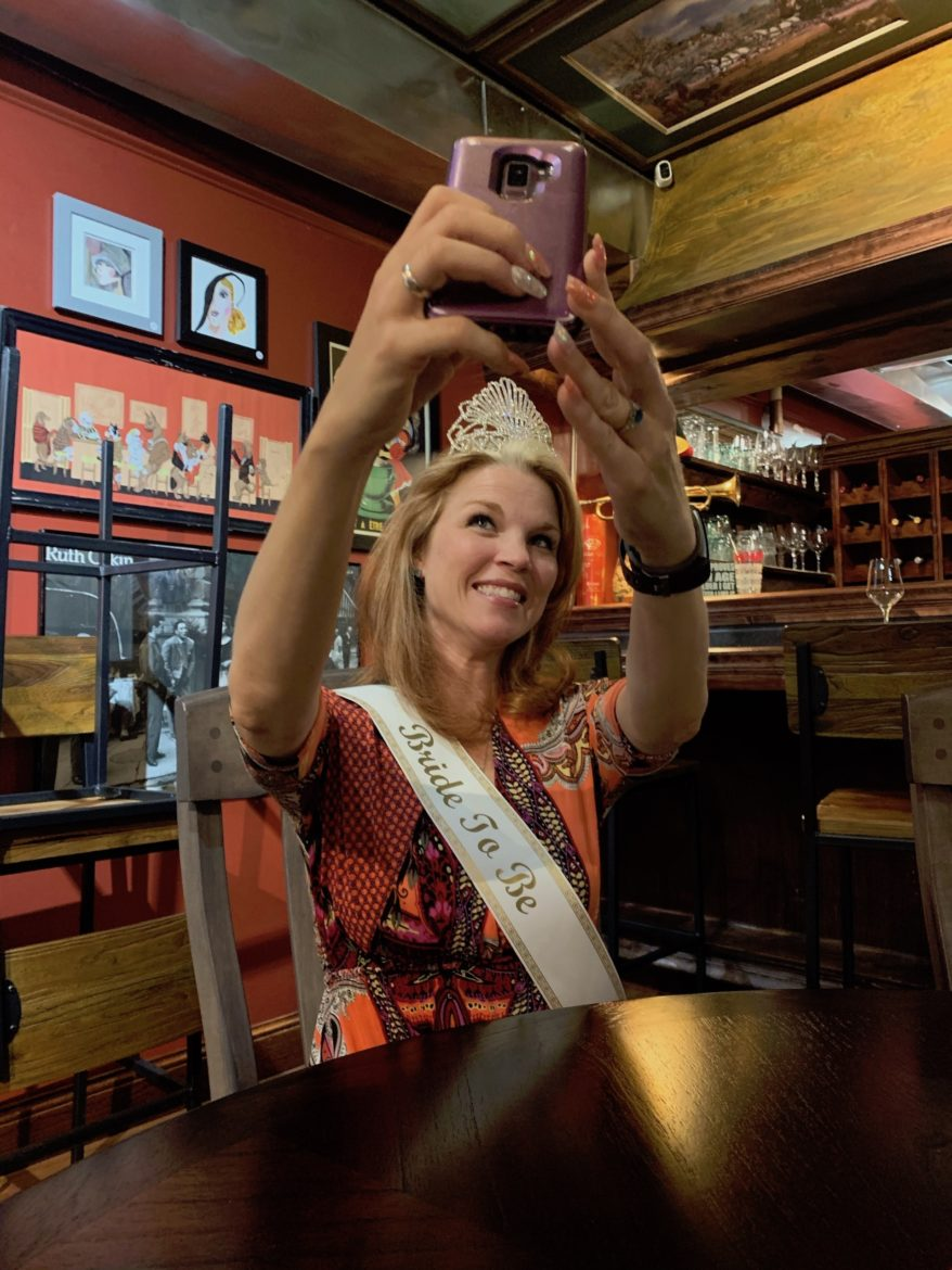 Stacy snaps a selfie in a tiara and 'Bride To Be' sash.