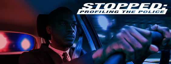 Stopped: Profiling the Police; Youngish Black male behind wheel of car with red and blue lighting