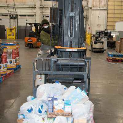 Food is loaded onto a forklift at Harvesters
