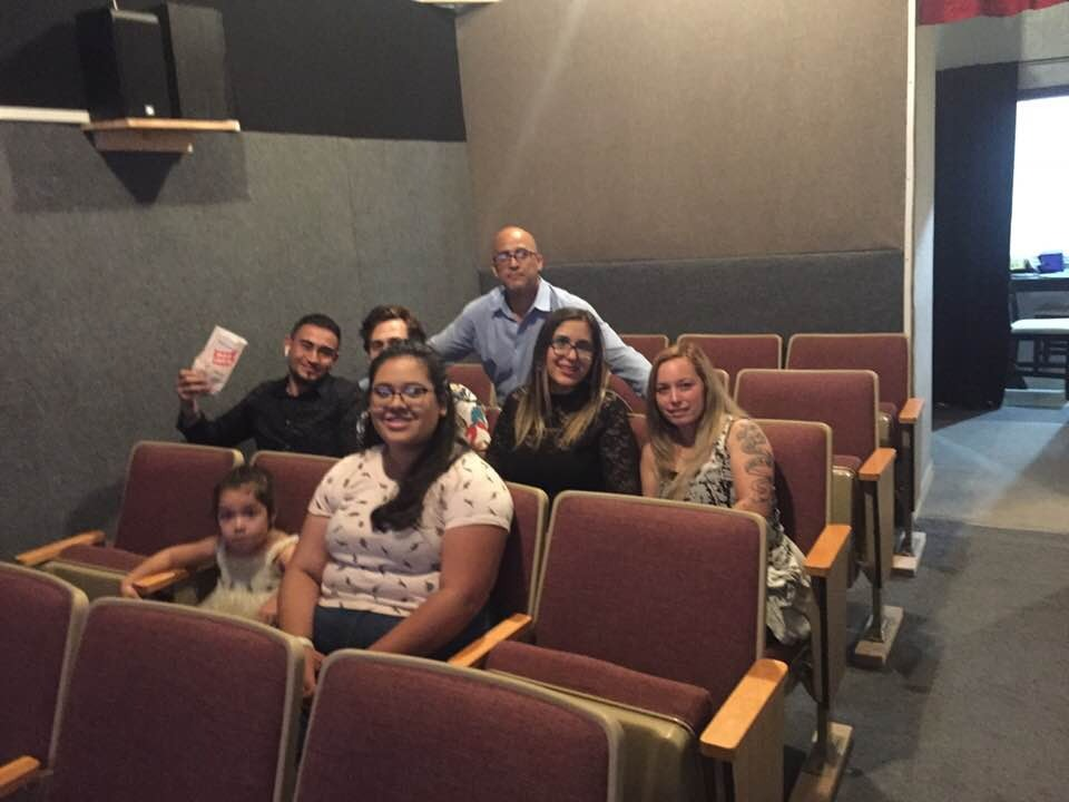Yosmel Serrano, pre-pandemic, poses with patrons in his small Latino theater in Northeast Kansas City. He sees his businesses as a way to education the Kansas City community of Spanish-language films. (Contributed)