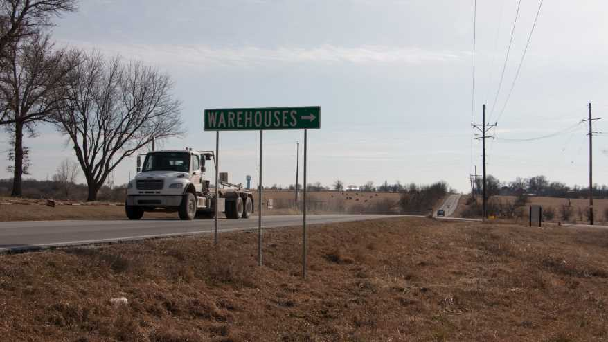 A semi truck whizzes past on Gardner Road.