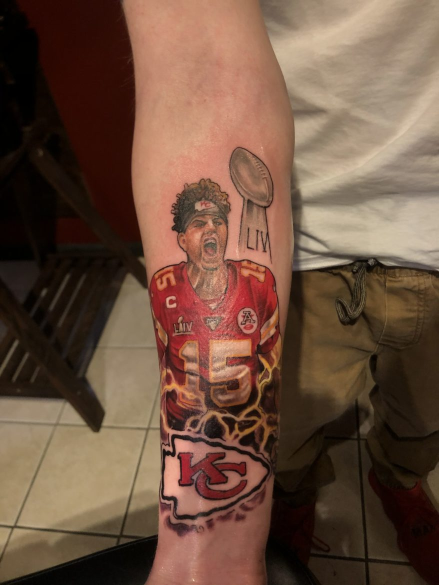 Zach Peterson shows off his Chiefs-inspired ink.