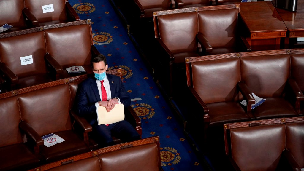 U.S. Sen. Josh Hawley (R-MO) sits alone in the House Chamber before a joint session of Congress on Jan. 06, 2021 in Washington, D.C.