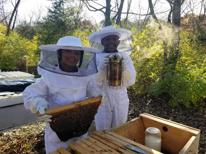 Valentina and Zacherie Depradine learn about beekeeping. Mead is made by fermenting honey.