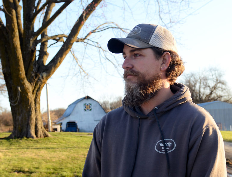 Andrew Geiser stands on his family's 100-year-old farm on Friday, March 19, 2021, in Chillicothe, Missouri.