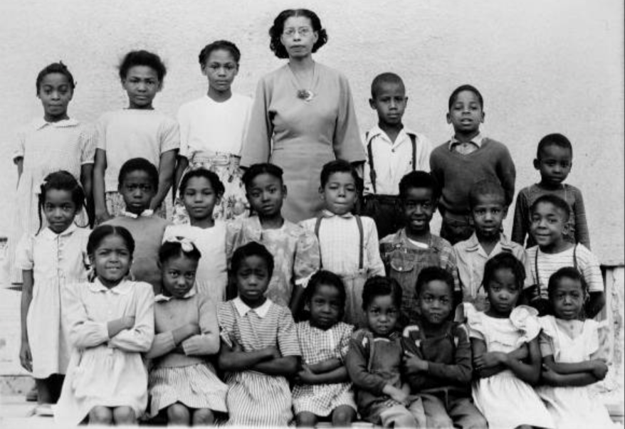 Corinthian Nutter poses with pupils at the Walker School in 1949.