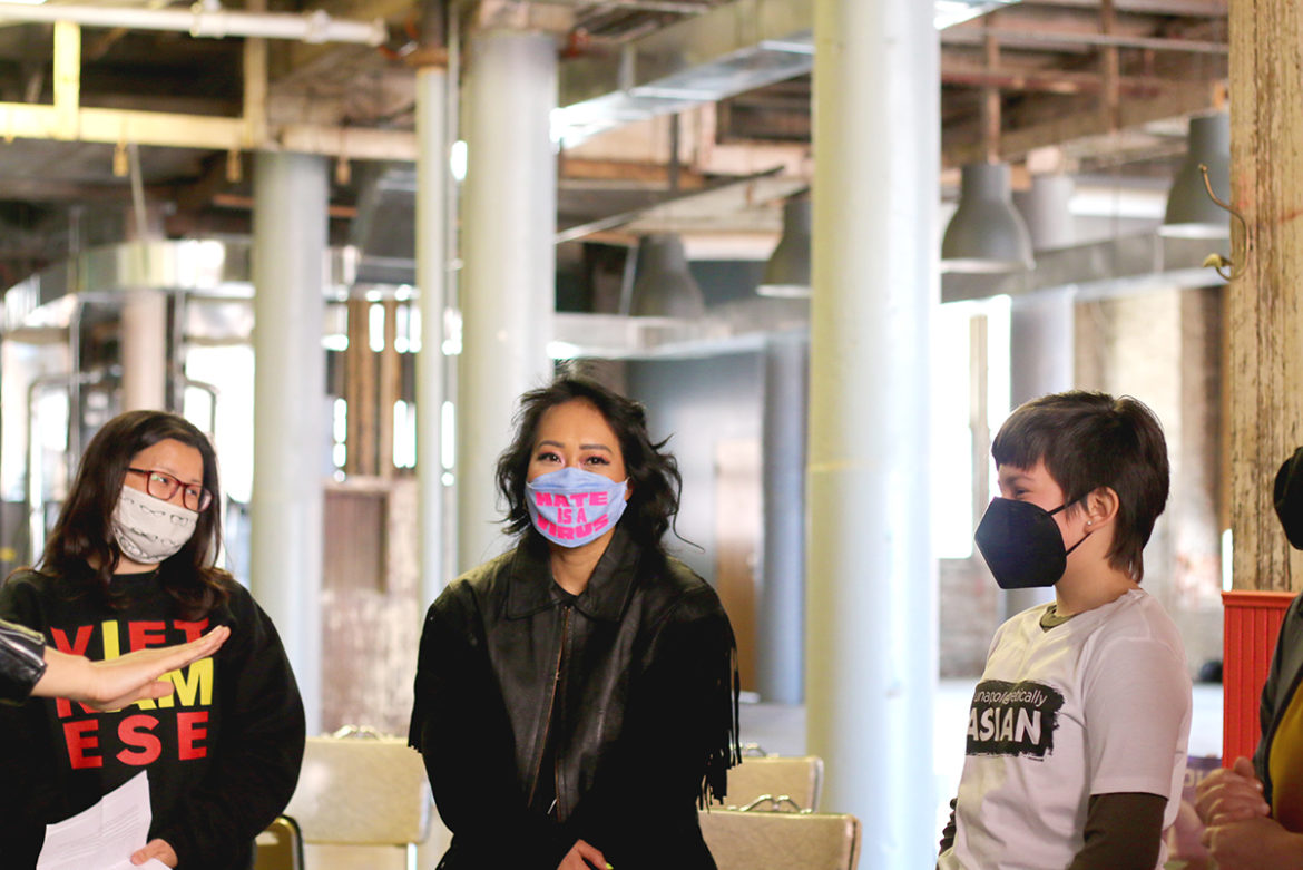 Jackie Nguyen (center) meets with two of the vigil speakers before it began. (Nicole Dolan | Flatland)