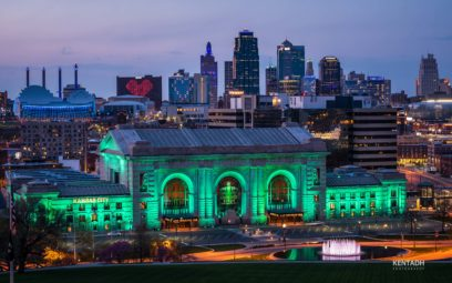 Union Station and the Kansas City skyline lit up at night.