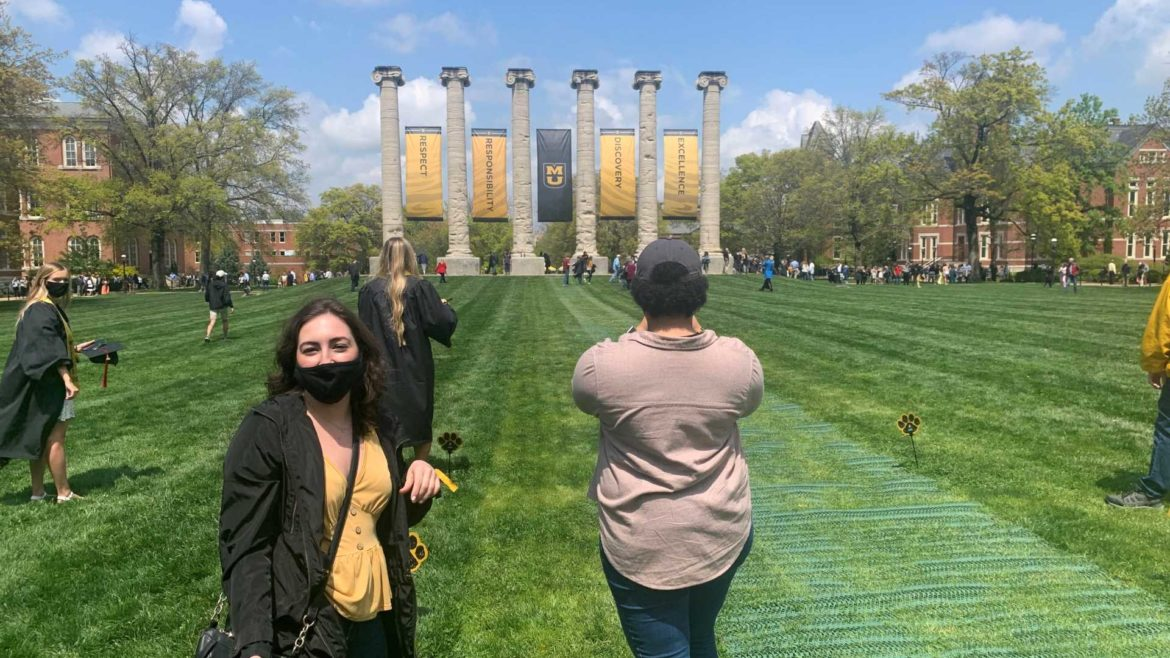 Juliana Tornabene and Mariah Doss stand in line before running through the columns at the University of Missouri on Saturday, April 24, 2021.